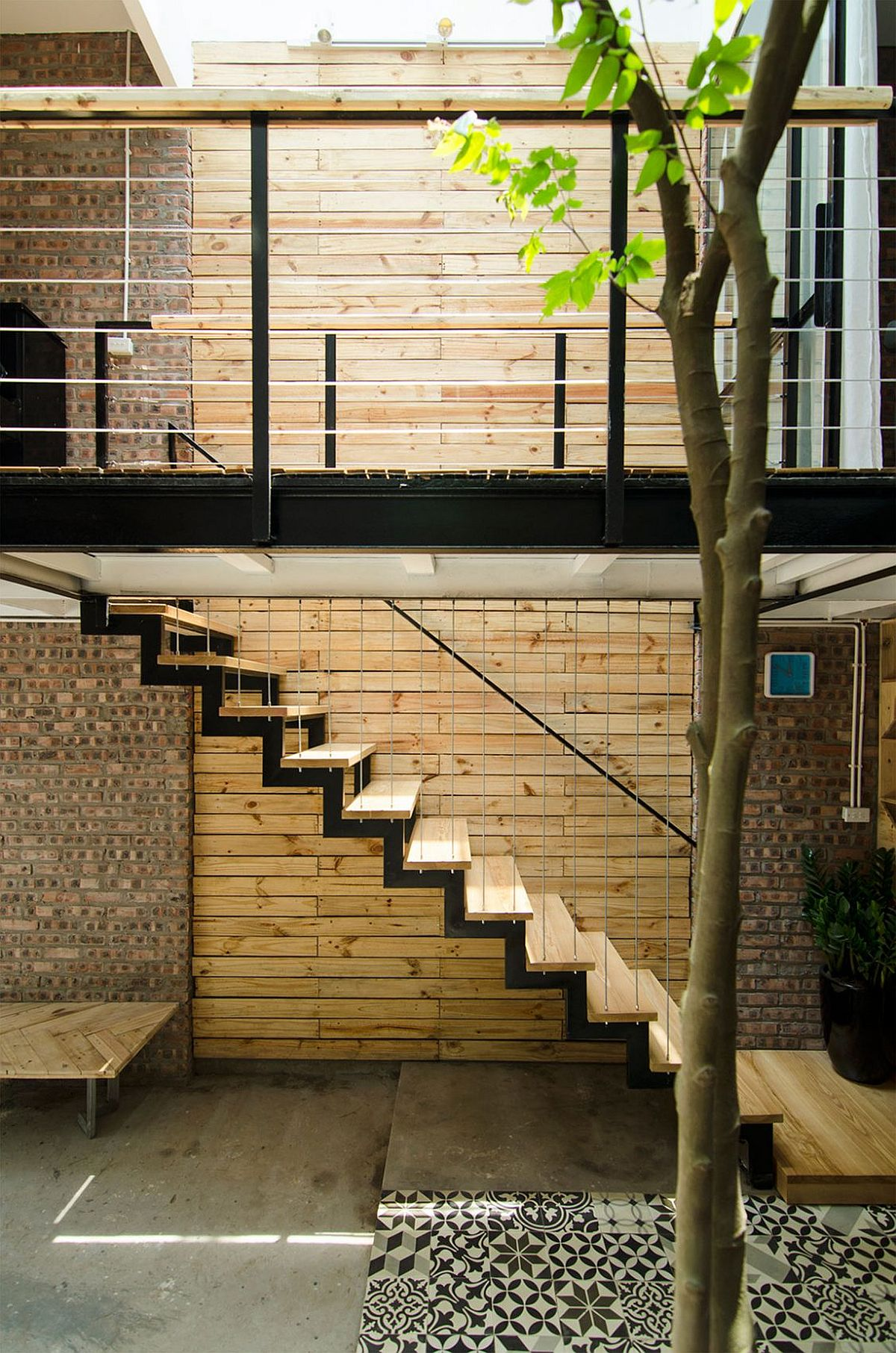 Wood and brick surfaces add textural beauty to the small interior