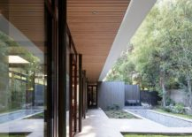 Wood-ceiling-and-stone-floor-define-the-beautiful-residence-with-cool-indoor-outdoor-interplay-217x155