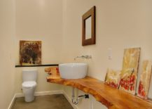 Wood-slab-vanity-is-a-showstopper-in-this-narrow-bathroom-217x155