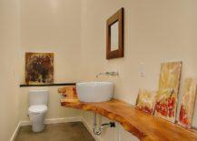 Wood slab vanity is a showstopper in this narrow bathroom