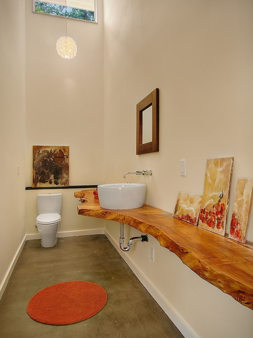Wood slab vanity is a showstopper in this narrow bathroom