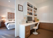 Wooden cabinets brings warmth to the home office in white next to the master bedroom
