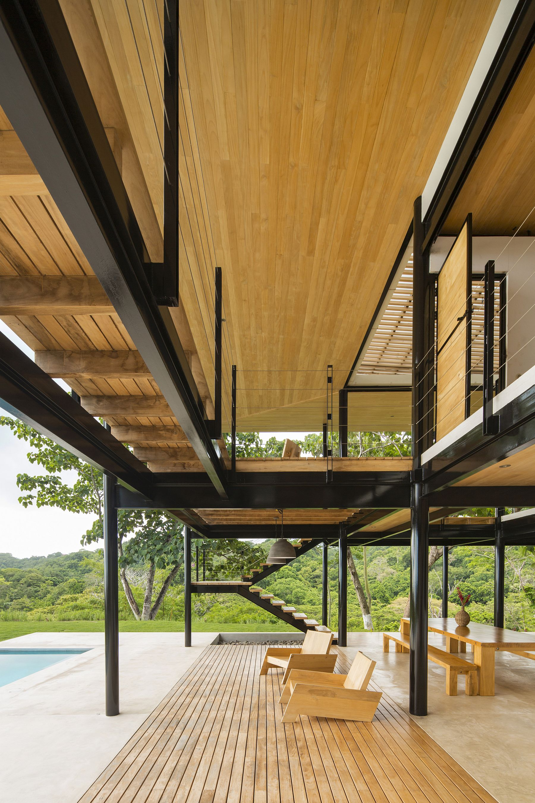 Wooden ceiling and terraces give the interior an inviting appeal