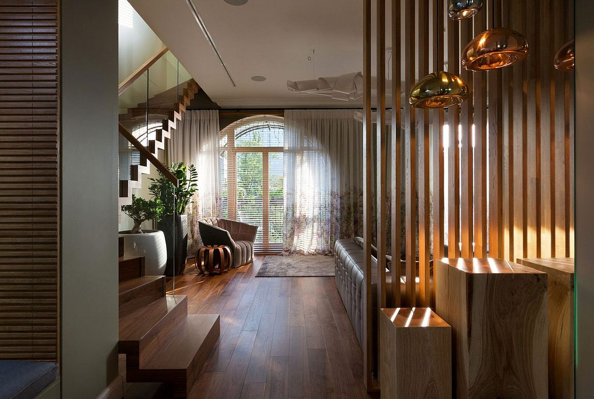 Wooden slats filter in sunlight even while creating a private living space