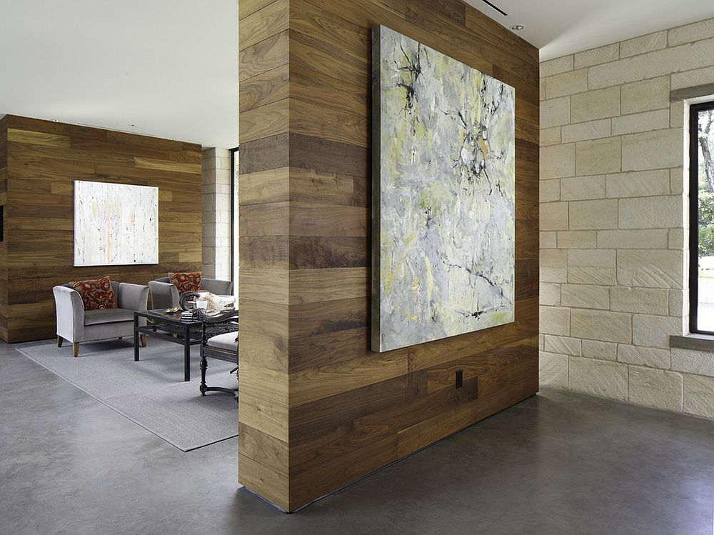 Woodsy room divider also allows you to showcase wall art [Design: Cornerstone Architects / Photography by Andrew Pogue]