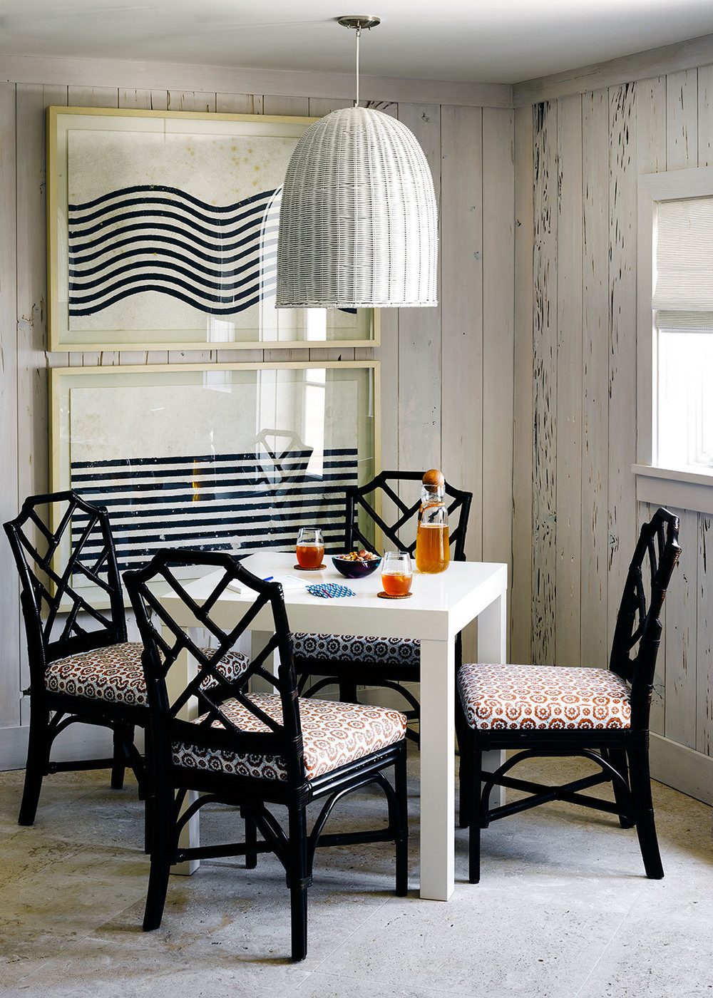 Woven lighting over a corner eating nook