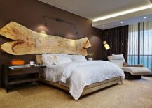 A stunning addition to the headboard wall - raw slab of wood!