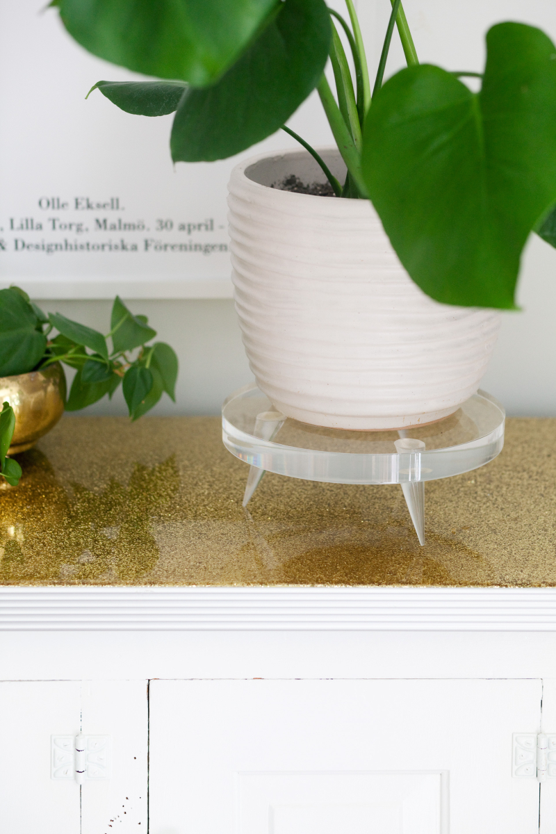 Acrylic plant pedestal from A Beautiful Mess