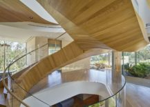 Amazing-curvy-staircase-delineates-spaces-and-adds-extravagance-to-the-interior-217x155