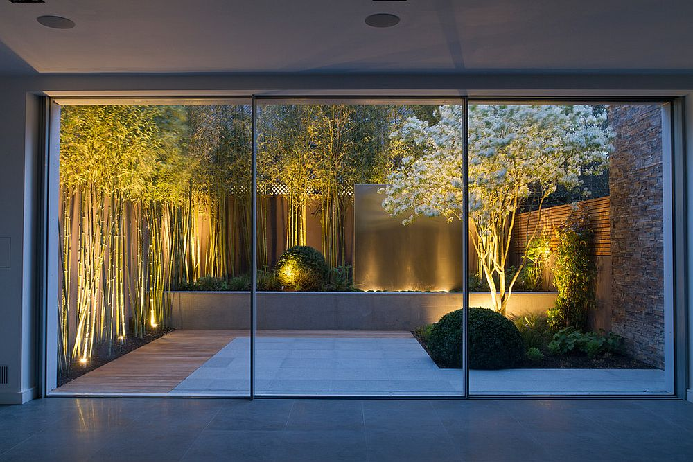 View In Gallery Bamboo White Flowers And A Water Feature Turn This Small Garden Into Showstopper