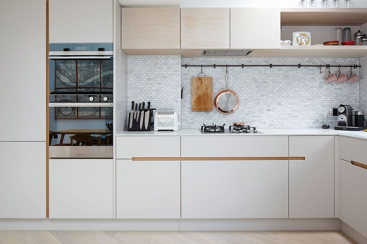 Beautiful tiled backsplash for the small kitchen in white with smart white cabinets