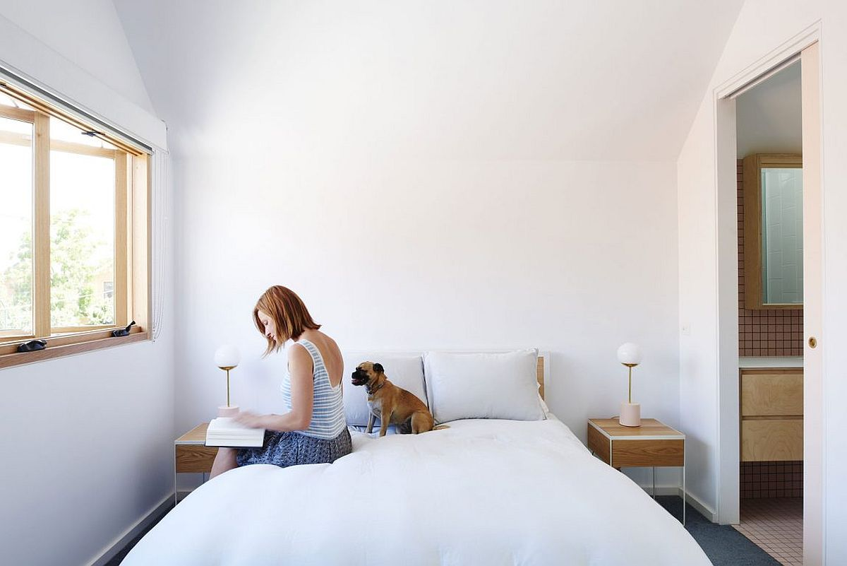 Bedside tables bring symmetry and style to the minimal white bedroom