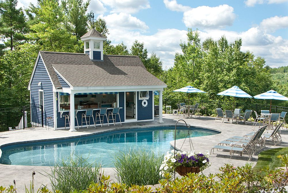 Blue and white give the pool house a distinct nautical appeal [Design: Liberty Hill Construction]