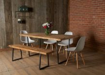 Brick and reclaimed wood brought together in the modern dining room