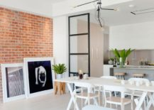 Brick-wall-and-art-work-give-the-London-apartment-an-NYC-inspired-look-217x155