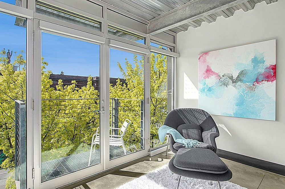 Bright and cheerful industrial sunroom with small balcony next to it [Design: David Robertson Design]