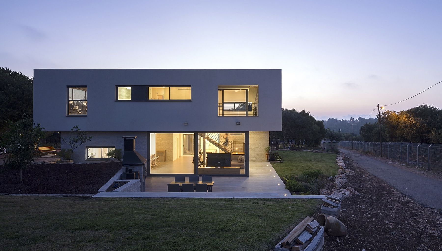 Cantilevered top section of the house gives it a cool sculptural vibe