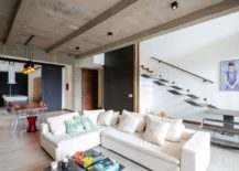 Cast-in-place concrete ceiling and beams are left exposed iniside the apartment
