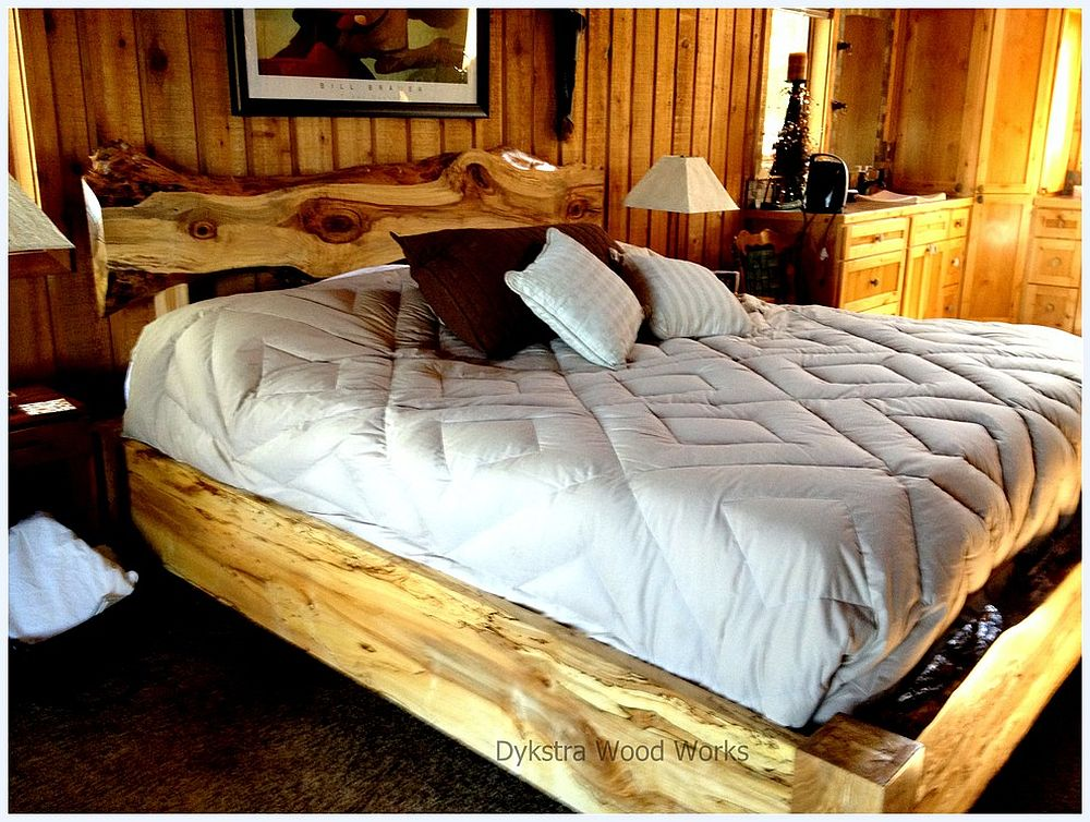 Cedar slab acts as headboard in this cool bedroom [From: Dykstra Wood Works]