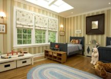 Classic boys bedroom with striped walls and skylight