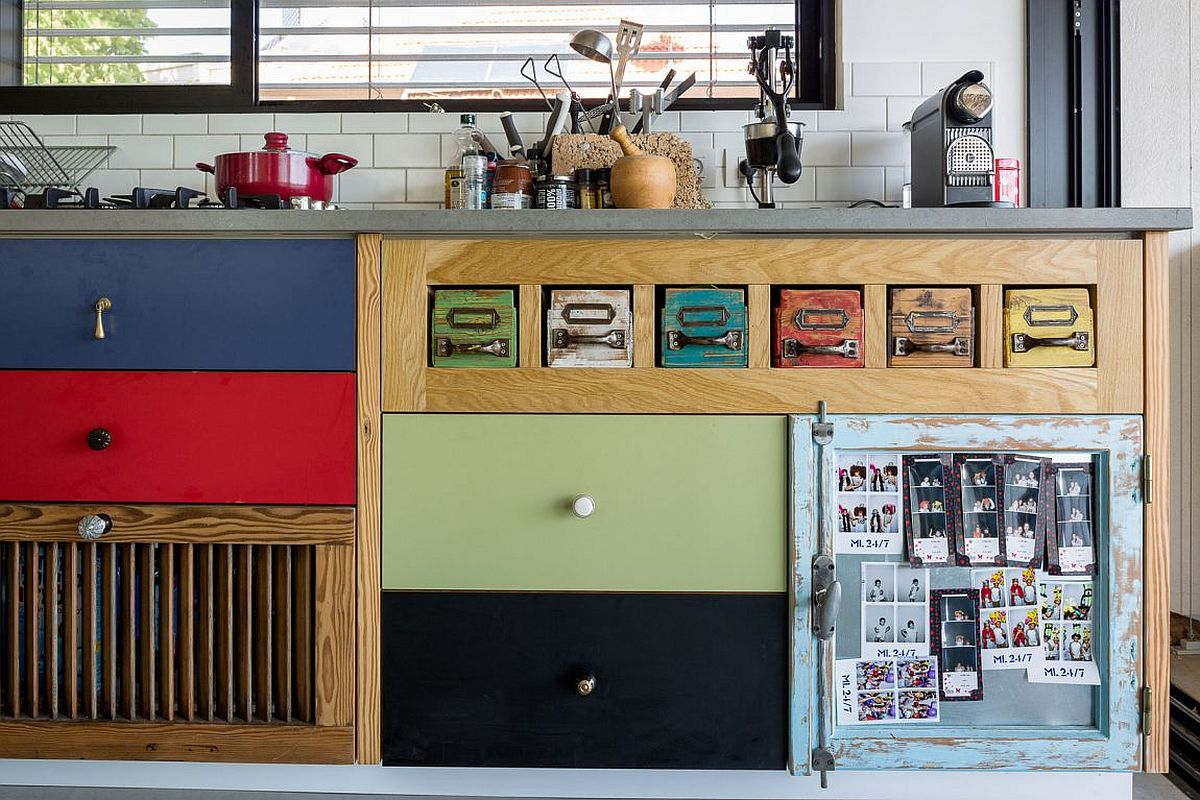 Colorful wooden cabinets in the kitchen bring cheerful allure