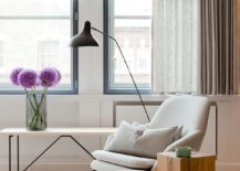 Comfy-chair-in-white-and-wooden-side-table-for-the-elegant-living-room-of-London-penthouse-217x155