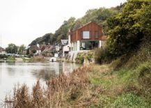 Concrete and cor-ten steel home on the banks of River Ouse
