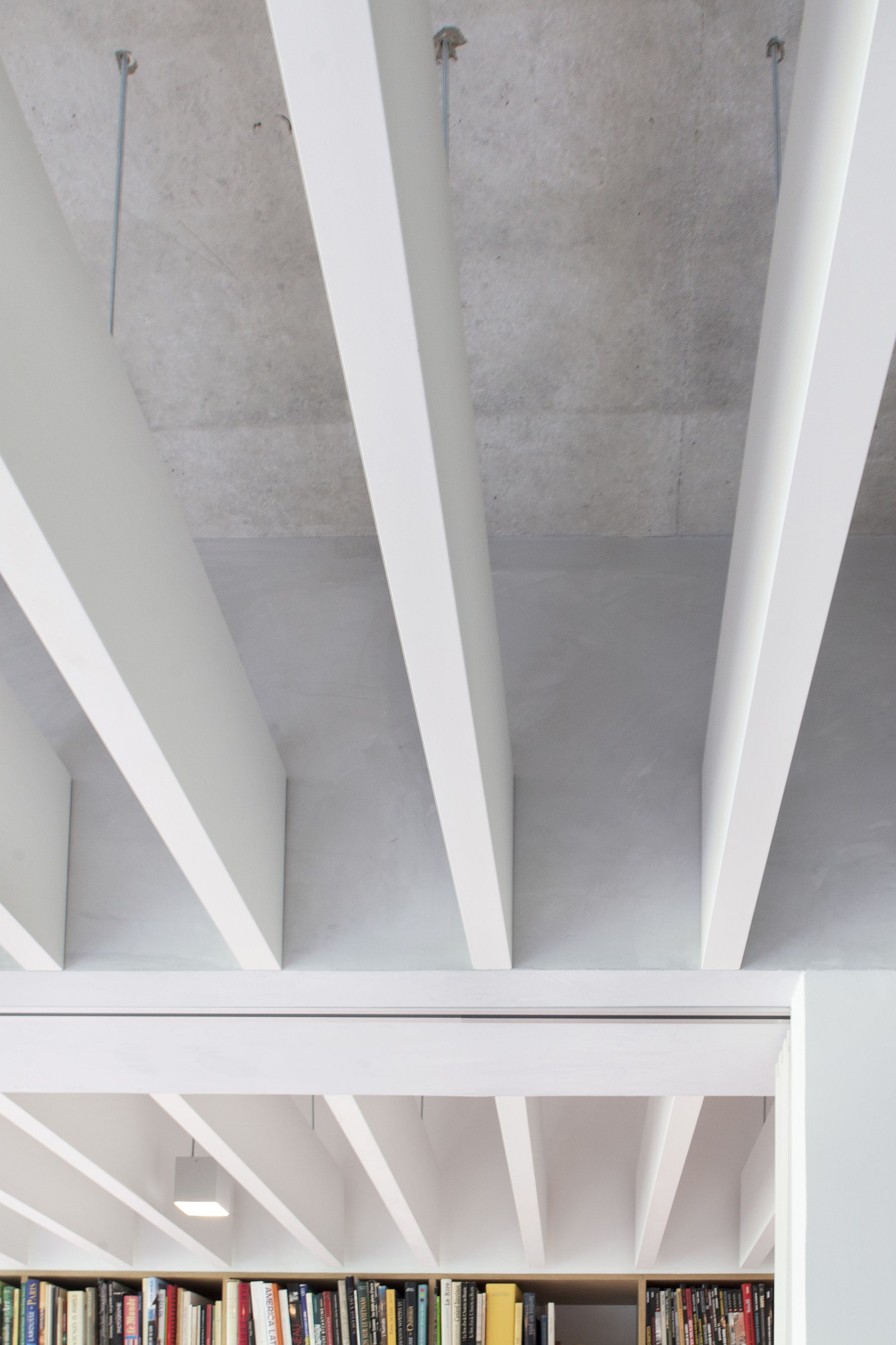 Concrete and wooden slats-made false ceiling inside the apartment