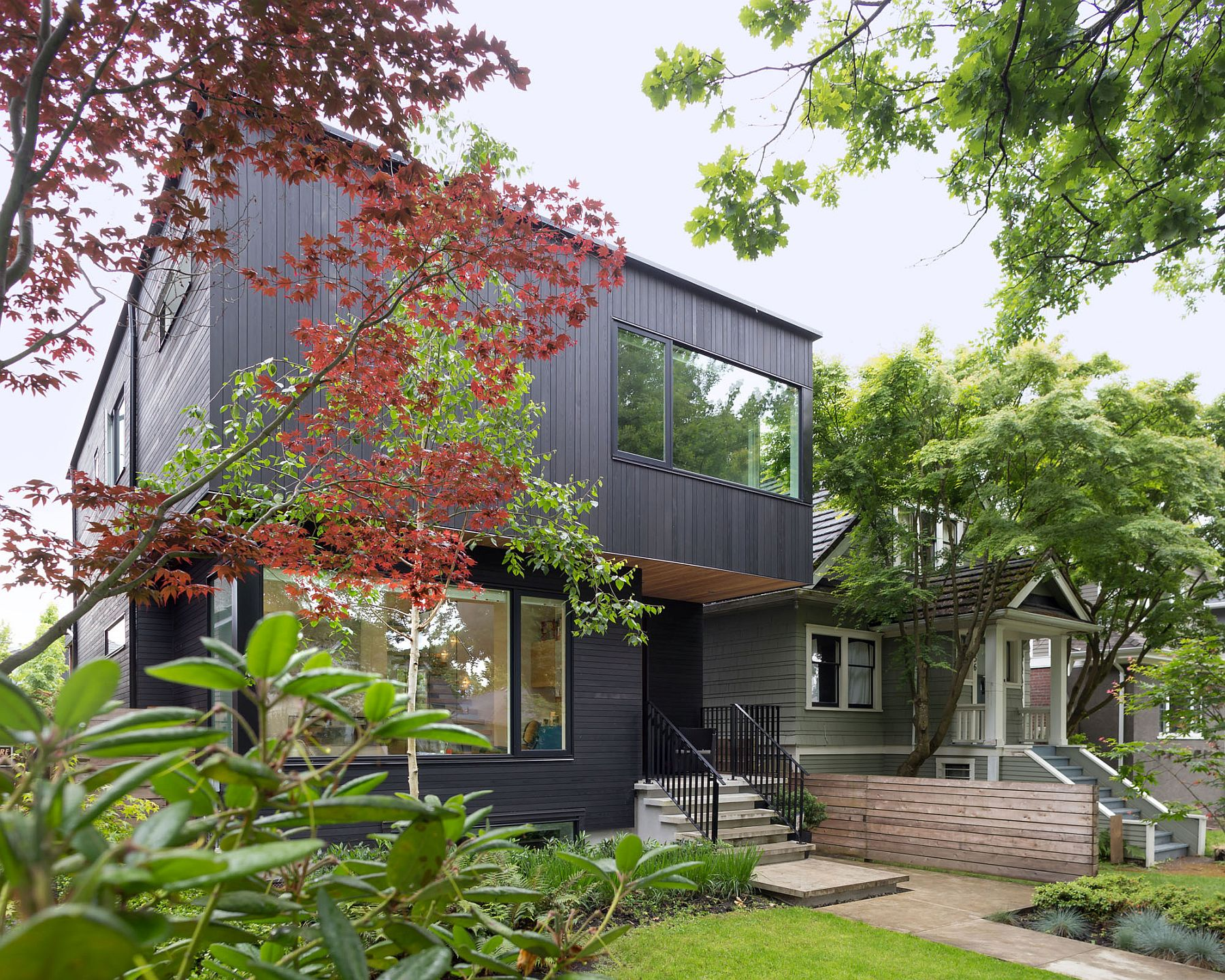 Contemporary Vancouver home with dark cedar exterior and cantilevered top level