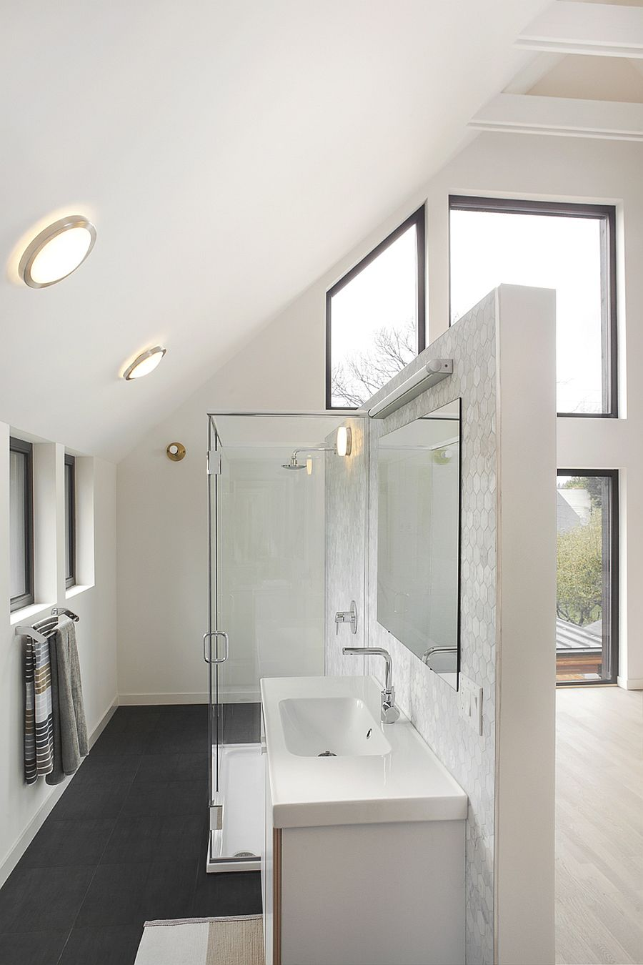 Contemporary bathroom in white has a spacious and cheerful appeal