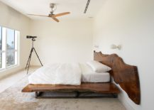 Contemporary bedroom in white with live edge headboard