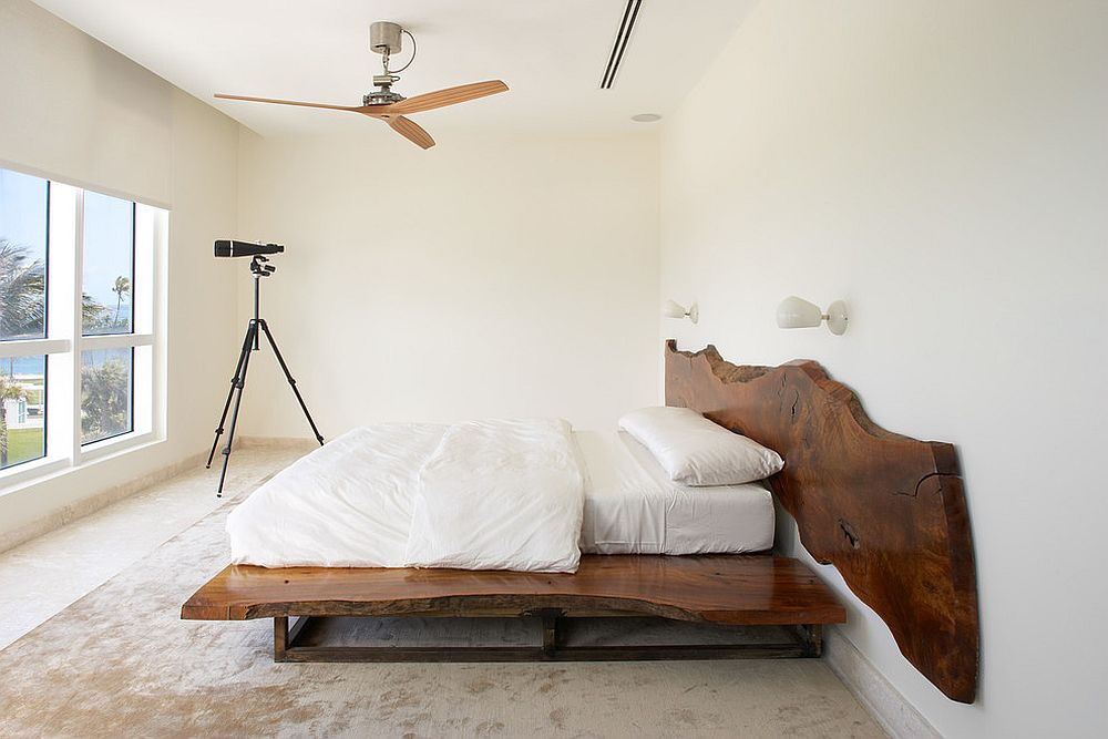 Contemporary bedroom in white with live edge headboard [Design: Magdalena Keck Interior Design]