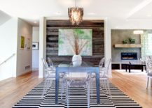 Contemporary dining room with acrylic dining tables and reclaimed wood accent wall