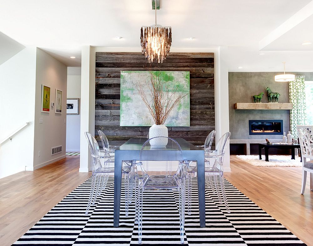 Contemporary dining room with acrylic dining tables and reclaimed wood accent wall [Design: AMEK Custom Builders]