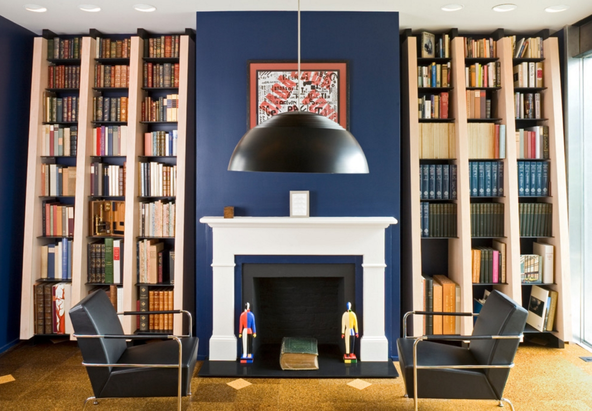 Contemporary drawing room with modern bookshelves