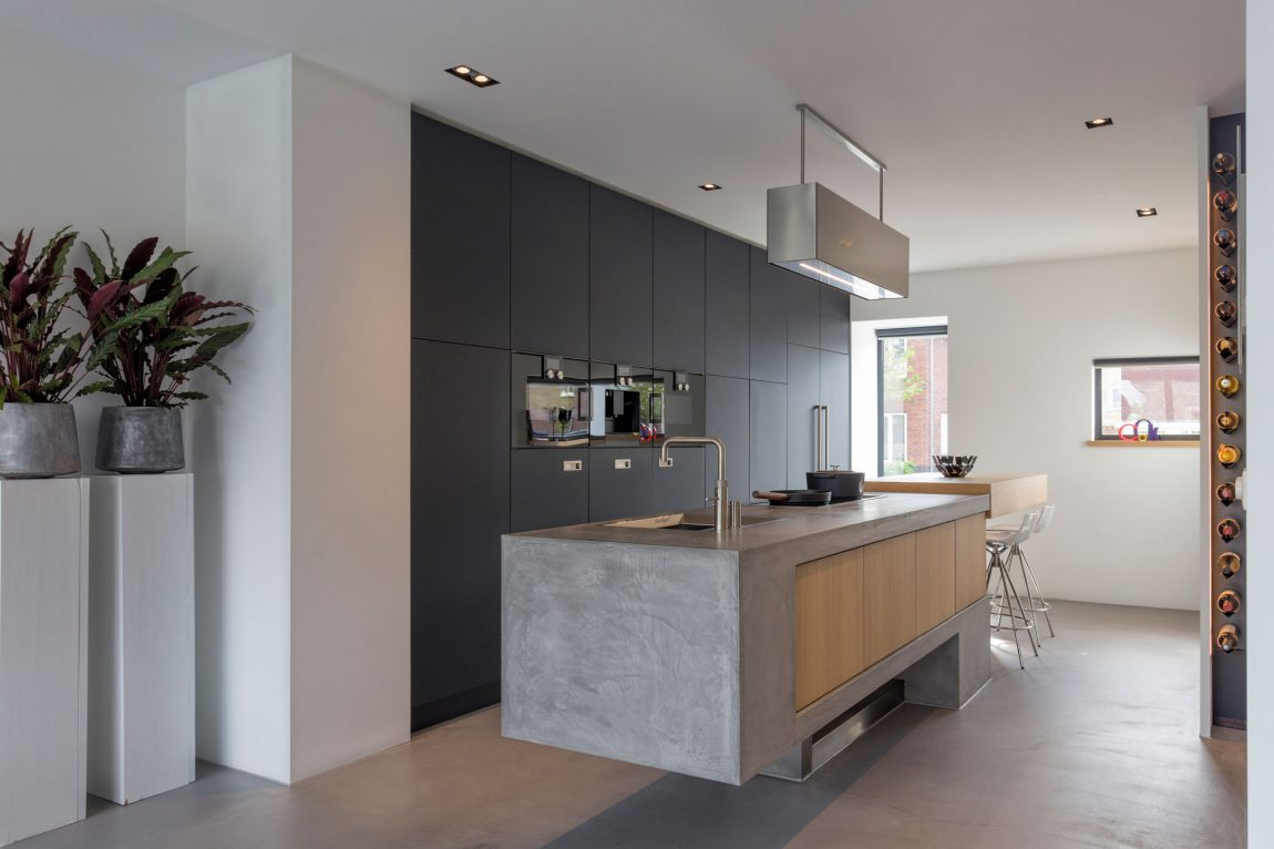 Contemporary kitchen with concrete kitchen island