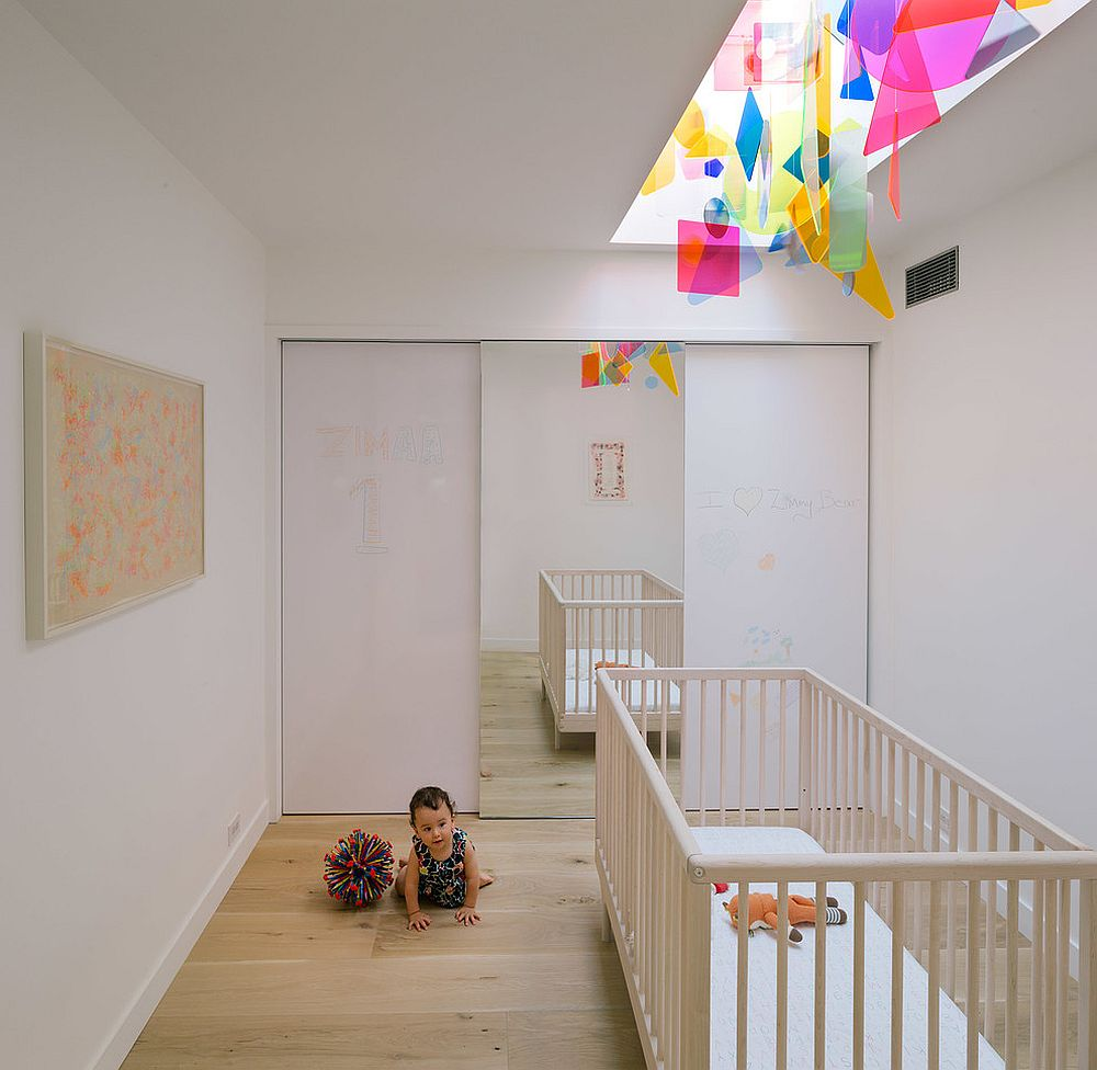 Contemporary nursery with colorful fixture above the crib [From: Miguel de Guzman / ImagenSubliminal]