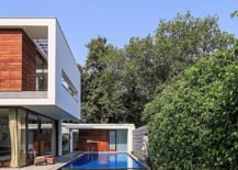 Contemporary-pool-ahd-shaded-deck-with-a-small-pool-house-217x155