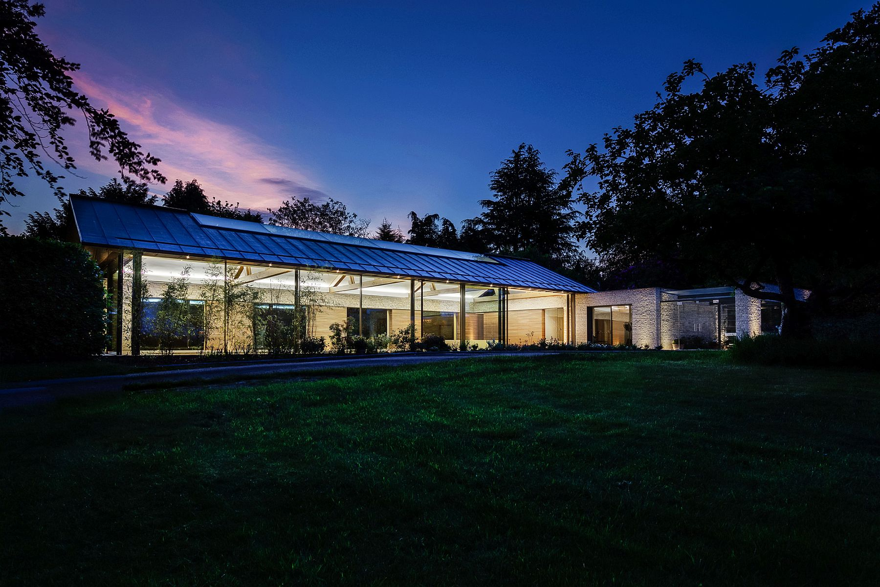 Copper-pitched-roof-gives-the-contemporary-pool-house-spa-and-gym-a-unique-identity