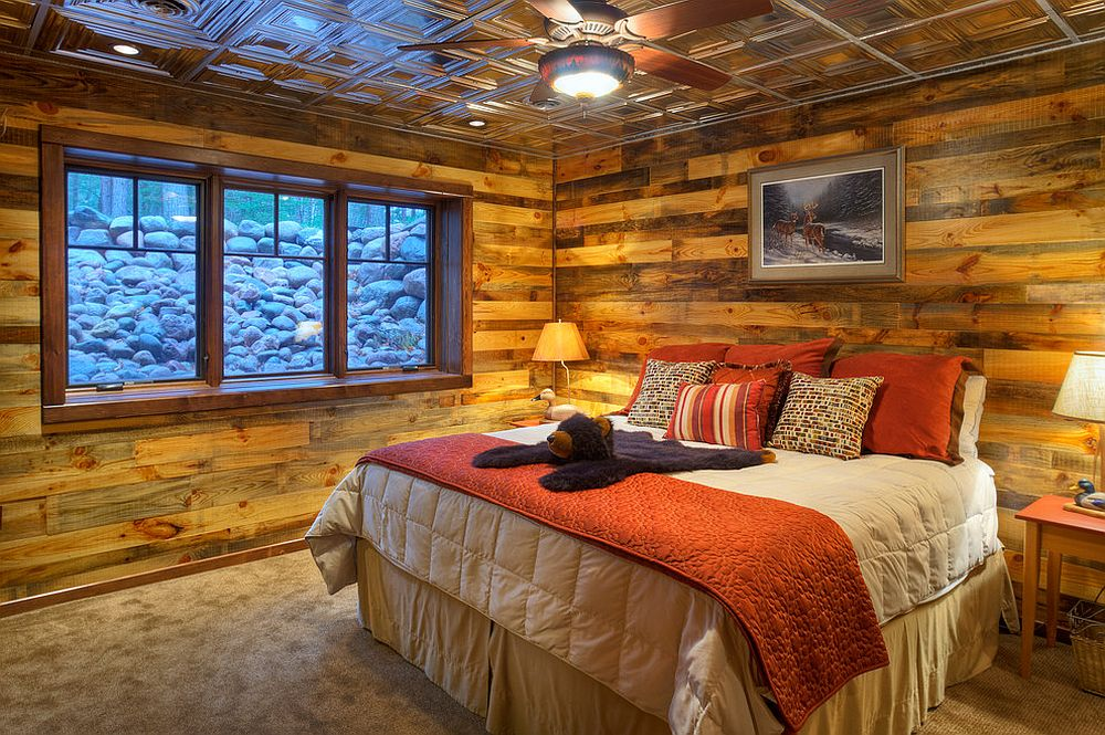 Cozy rustic bedroom clad in wood and metal [Design: Tomahawk Log & Country Homes]
