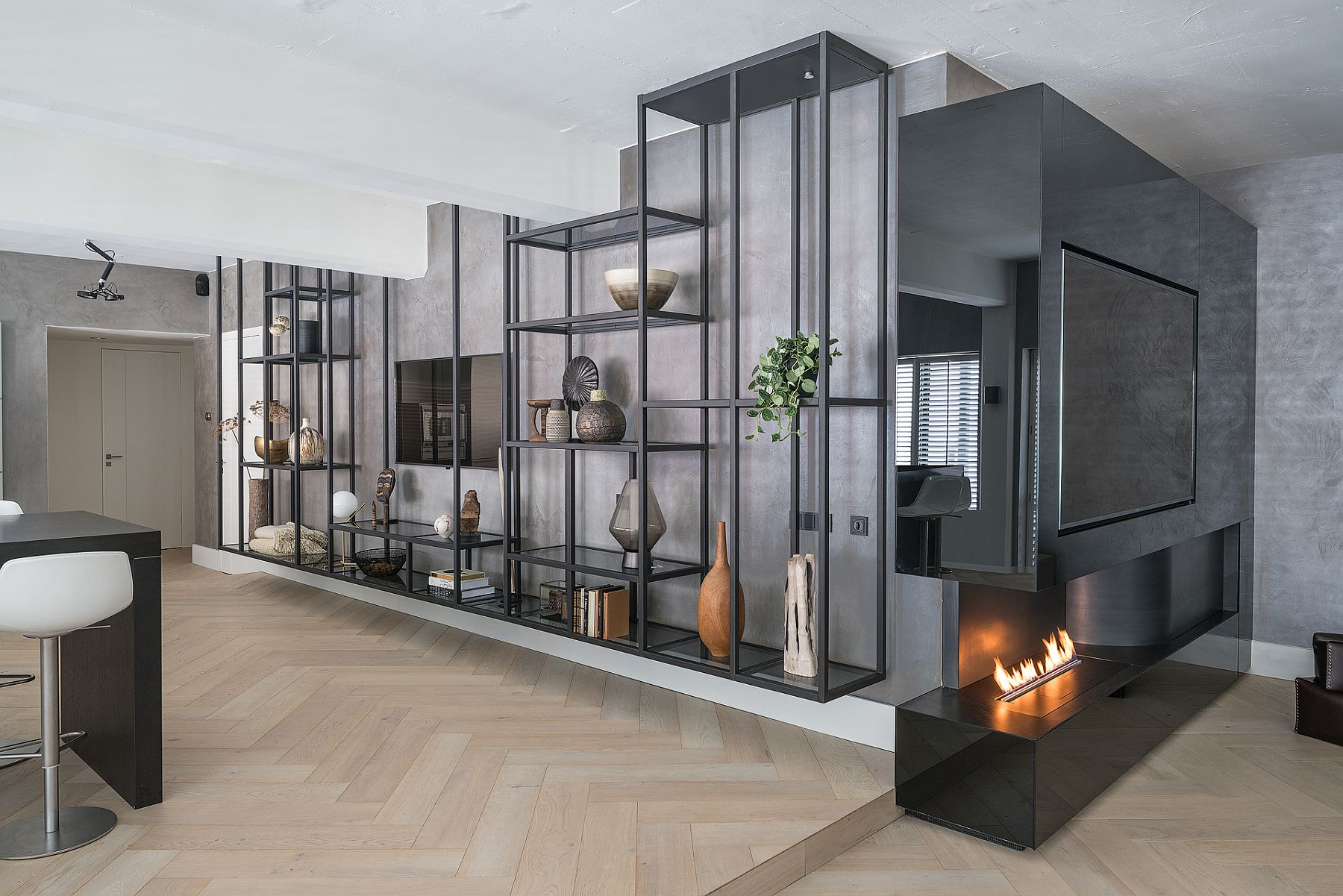 Custom industrial shelf is perfect for the spacious loft in Brussels