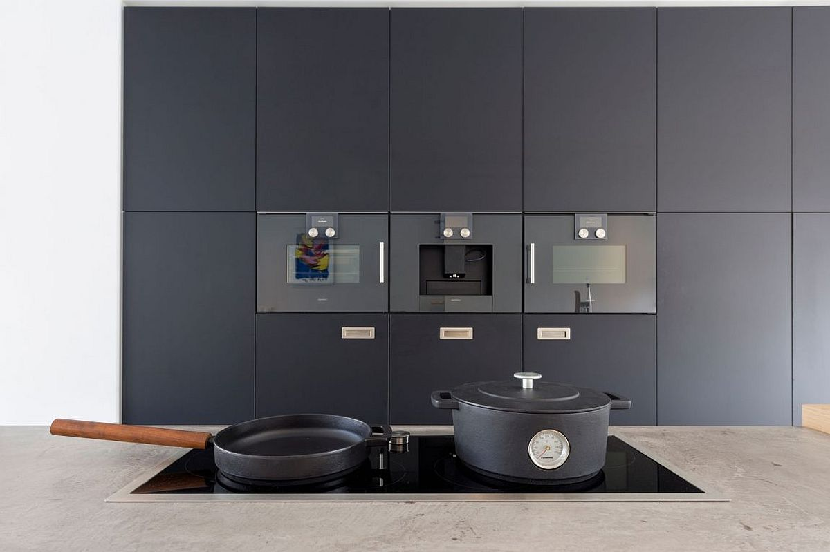 Dark wall of cabinets and appliances in the kitchen