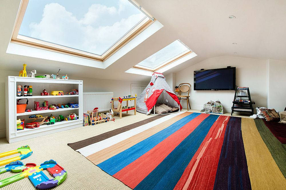 Decor and toys bring color to the kids' playroom with large skylights [Design: Orchestrate]