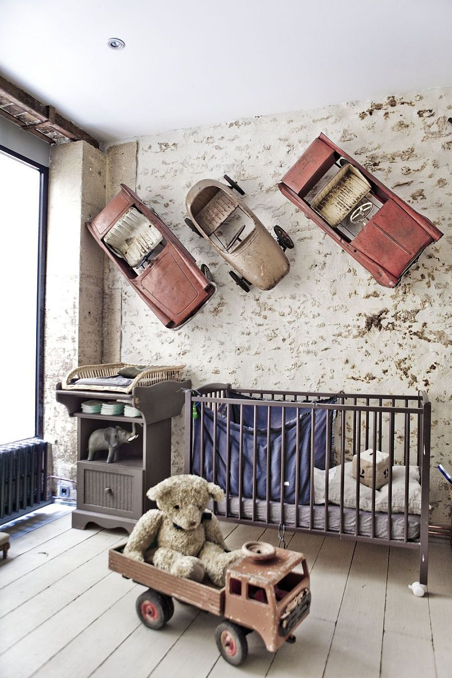 Decorative items on the wall turn this nursery into a showstopper