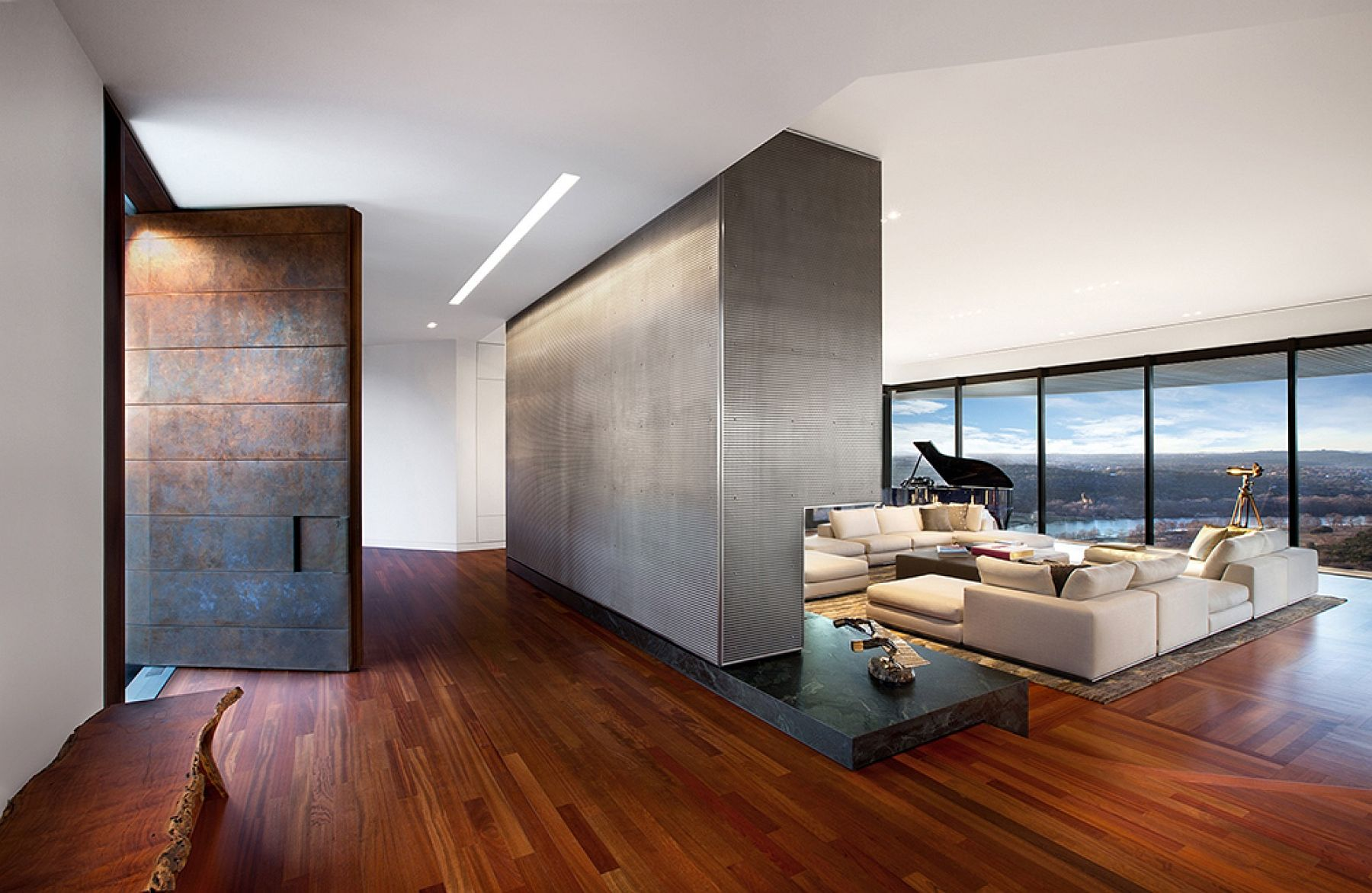 Design of the new entrance and fireplace hides the views and reveals them gradually