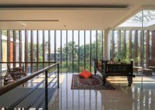 Design-of-the-top-level-with-glass-walls-and-wooden-slats-combines-privacy-with-smart-ventilation-217x155