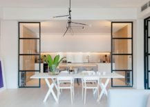 Dining-area-and-kitchen-seperated-by-framed-glass-partitions-with-industrial-style-217x155