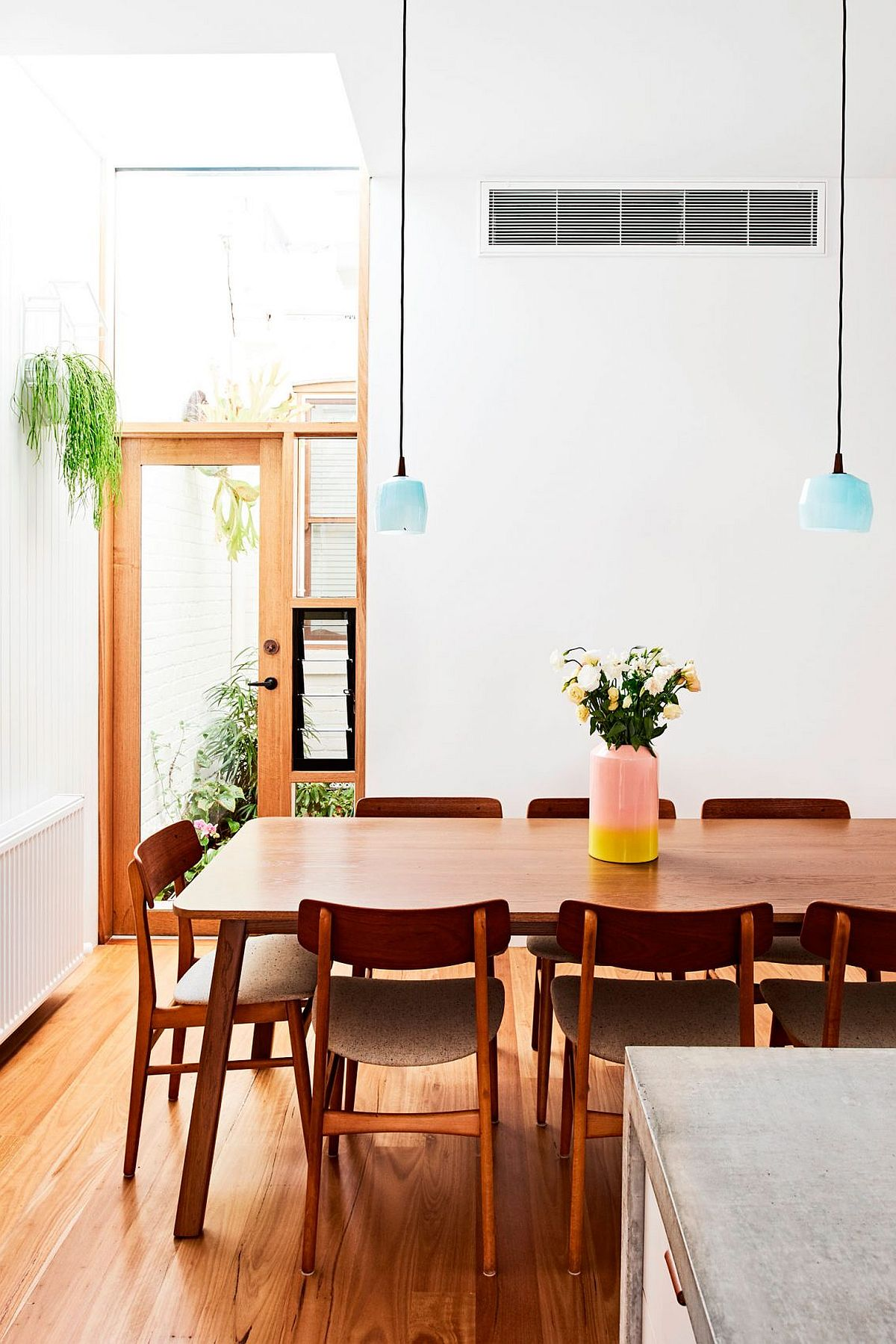 Dining area inside the renovated terrace house in Fitzroy North