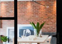 Dining-area-with-industrial-style-sliding-glass-doors-and-brick-wall-backdrop-217x155