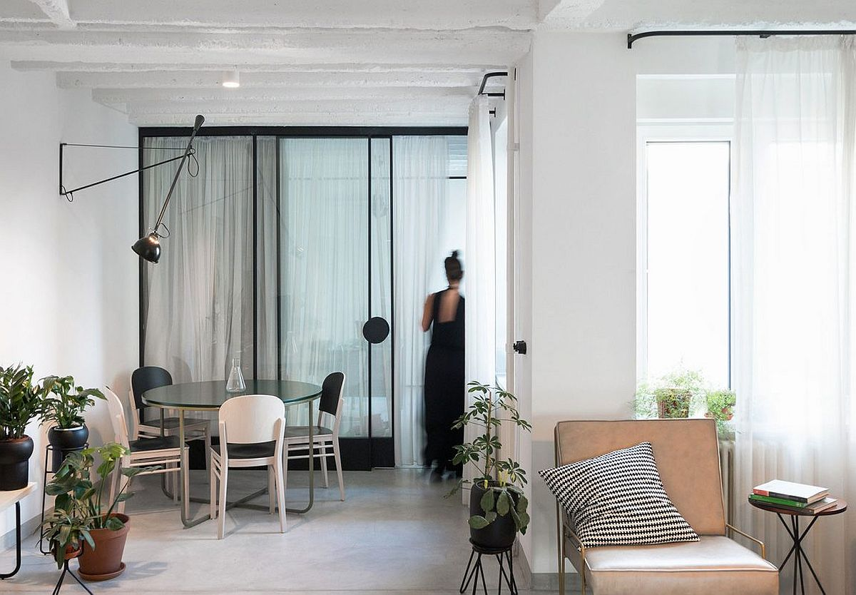 Dining room with sliding glass doors and drapes that seperate it from the private spaces